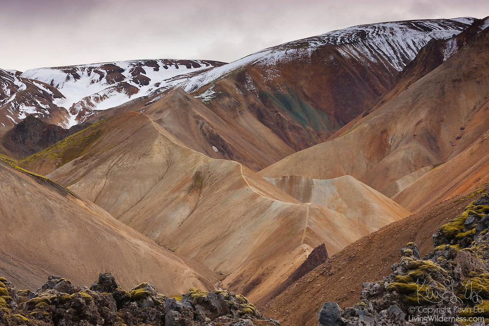 Fresh snow coats the summits of the peaks at Landmannalaugar, located in the highlands of Iceland. Landmannalaugar, part of the Fjallabak Nature Reserve, sits at the edge of the Laugahraun lava field, which was formed in an eruption around the year 1477.