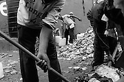 """NAIROBI, KENYA - AUGUST 15, 2011: On a plot that was formerly a dump site, the youth of Gange Youth Group have cleared the space to open a car washing business. Gange, which means """"hard working,"""" was started in 1996, and was the first youth reform project to take root in Kibera. """"We manage to go on with our life"""" said Rashid Seif, 28, a member of Gange Youth. """"For now, we can make peace. We want to be a peacemaker. We must come with our own vision. We have the idea to be stronger than during the last election.""""<br /> <br /> Various grassroots initiatives led by youth have begun to improve the quality of life for those living in the direst of conditions, and young people of different tribes are using gardening, waste removal, education and athletics to encourage their peers toward a self-respecting and self-sustaining community. Termed """"youth groups"""" on the street, these initiatives could represent the future of long-term socioeconomic development in Kenya while laying the groundwork for a more peaceful election in 2013. During the post-election violence of 2007 and 2008, impoverished youth in Kenya were routinely bribed by the nation's political elite to carry out acts of violence in their communities. Idleness among the youth, combined with the nation's history of tribal rivalries, were cited as a key factors to the violence, culminating in the deaths of over 1,200 Kenyans and the displacement of over 600,000. Since the violence, many youth have begun to seize active roles in the reform of their nation. In 2010 United States Ambassador Michael Ranneberger said he sensed """"a sea change of attitude"""" among youths, """"a tidal wave below the surface. The youth have woken up."""""""