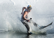A skier starts to fall while crossing the water during the Wacky Water Event at the Spring  Rally at Mount Peter Ski and Ride in Warwick, New York. The Spring Rally traditionally closes the season at the ski area.