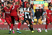 Newcastle United defender Isaac Hayden (14) lays off the pass during the Premier League match between Liverpool and Newcastle United at Anfield, Liverpool, England on 14 September 2019.