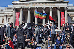 © Licensed to London News Pictures. 15/03/2014. London, UK. Anti Fascist groups march in Trafalgar Square in order to interrupt the demonstration of th eFascist group E.V.F. to Parliament Square. Photo credit : Andrea Baldo/LNP