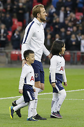 BRITAIN-LONDON-FOOTBALL-PREMIER LEAGUE-TOTTENHAM HOTSPUR VS WATFORD.(180430) -- LONDON, April 30, 2018  Tottenham Hotspur's Harry Kane walks with mascots before the Premier League football match between Tottenham Hotspur and Watford at Wembley Stadium in London, Britain on April 30, 2018.  Tottenham Hotspur won 2-0.  FOR EDITORIAL USE ONLY. NOT FOR SALE FOR MARKETING OR ADVERTISING CAMPAIGNS. NO USE WITH UNAUTHORIZED AUDIO, VIDEO, DATA, FIXTURE LISTS, CLUB/LEAGUE LOGOS OR ''LIVE'' SERVICES. ONLINE IN-MATCH USE LIMITED TO 45 IMAGES, NO VIDEO EMULATION. NO USE IN BETTING, GAMES OR SINGLE CLUB/LEAGUE/PLAYER PUBLICATIONS. (Credit Image: © Tim Ireland/Xinhua via ZUMA Wire)