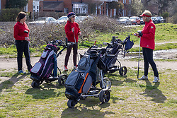 """© Licensed to London News Pictures. 29/03/2021. London, UK. Golfers queue up as they wait to tee off on Wimbledon Common golf course, South West London as the """"Stay at Home"""" government advice ends. From today, Monday 29 March, the """"Stay at Home"""" advice will end with people being allowed to meet up within the """"rule of six"""". Playing golf, tennis and organised outdoor sports will also be allowed as England starts to unlock after a year of Covid-19 restrictions. Photo credit: Alex Lentati/LNP"""