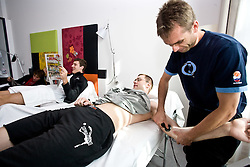 Goran Dragic and Uros Slokar of Slovenia at physiotherapist Gasper Suhadolnik in a Andel's Hotel during Eurobasket 2009, on September 15, 2009 in  Lodz, Poland.  (Photo by Vid Ponikvar / Sportida)