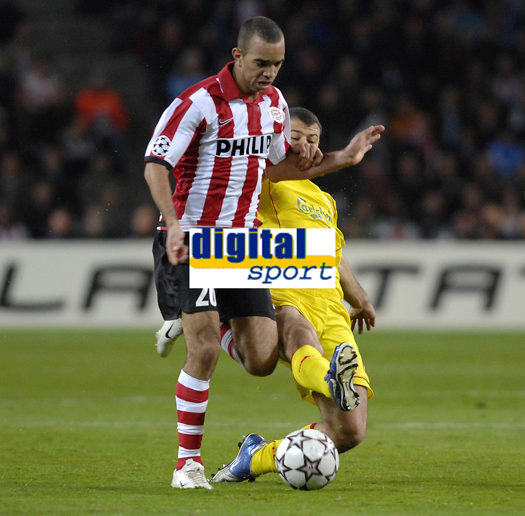 Photo: RIchard Lane.<br />PSV Eindhoven v Liverpool. UEFA Champions League, Quarter Final, 1st Leg. 03/04/2007. <br />PSV's Diego Tardelli is tackled by Liverpool's Javier Mascherano resulting in a yellow card.
