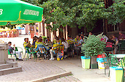 Discharged soldiers age 20 through 30 eating at outdoor sidewalk cafe  Torun Poland