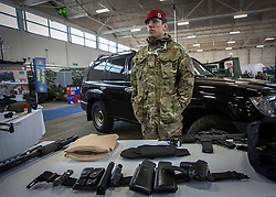 26/03/2014.  A member of the Royal Military Police (RMP) puts out some of the weapons used by the military Close Protection teams. The display was part of an effort by the British Army to put on show it's new specialist, combat and command skills formation today. This new part of the Army will be made up of 36000 Regular and Reserve soldiers, which is a third of the army as a whole and supports the logistics of operations both in the UK and abroad.  The command will officially launch on the 1 Apr 14.  Alison Baskerville/LNP