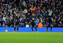 Tottenham Hotspur players cut dejected figures - Photo mandatory by-line: Dougie Allward/JMP - Tel: Mobile: 07966 386802 24/11/2013 - SPORT - Football - Manchester - Etihad Stadium - Manchester City v Tottenham Hotspur - Barclays Premier League