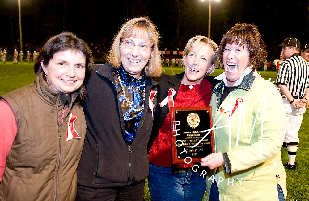 LHS Class of 1973 cheerleaders Marcia Main, Denise Kenney, Elaine Barrows and Jane MacFadzen were recognized for the State Cheerleading Championship in 1973 during Friday's homecoming football game against Plymouth.  (Alan MacRae/for the Citizen)