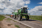 """2015/03/05 – Monte Maiz, Argentina: A """"mosquito"""", term used to name the machine that pulverizes the glyphosate on the soya cultivation is driven on the roads next to Monte Maiz. Many residents in town complain that parking pulverization machines and storing chemicals inside town and next to houses grows the risk of cancer and other related diseases. (Eduardo Leal)"""