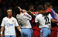 Photo: Javier Garcia/Back Page Images Mobile 07887 794393<br />03/01/2005 Crystal Palace v Aston Villa, FA Barclays Premiership, Selhurst Park<br />Darren Powell grabs Gareth Barry by the throat but went unnoticed by Referee Andy D'Urso