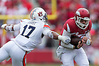 FAYETTEVILLE, AR - OCTOBER 24:  Brandon Allen #10 of the Arkansas Razorbacks runs the ball and is grabbed by Kris Frost #17 of the Auburn Tigers at Razorback Stadium on October 24, 2015 in Fayetteville, Arkansas.  The Razorbacks defeated the Tigers in 4 OT's 54-46.  (Photo by Wesley Hitt/Getty Images) *** Local Caption *** Brandon Allen; Kris Frost