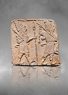 Aslantepe Hittite relief sculpted orthostat stone panel. Limestone, Aslantepe, Malatya, 1200-700 B.C. Anatolian Civilisations Museum, Ankara, Turkey. Scene of two Gods walking one carrying a spear, dressed in tunics.<br /> <br /> Against a grey art background. <br /> <br /> If you prefer to buy from our ALAMY STOCK LIBRARY page at https://www.alamy.com/portfolio/paul-williams-funkystock/hittite-art-antiquities.html . Type - Aslantepe - in LOWER SEARCH WITHIN GALLERY box. Refine search by adding background colour, place, museum etc.<br /> <br /> Visit our HITTITE PHOTO COLLECTIONS for more photos to download or buy as wall art prints https://funkystock.photoshelter.com/gallery-collection/The-Hittites-Art-Artefacts-Antiquities-Historic-Sites-Pictures-Images-of/C0000NUBSMhSc3Oo
