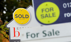 File photo dated 14/10/14 of Sold and For Sale signs. House sellers' average asking prices are now cheaper than they were a year ago Ð marking the first time this has happened in seven years, according to a website.