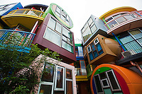 """Shusaku Arakawa designed Reverse Destiny Loft  Apartments in the Tokyo suburb of Mitaka in conjunction with his poet partner, Madeline Gins. Painted in bright colors, the building resembles a childrens playground.  Inside, apartments feature rooms with a grainy, surfaced floor that slopes erratically, electric switches are located in unexpected places on the walls so you have to feel around for the right one. One may wonder the purpose for all this, though the architect believes the apartments make you alert and awakens your instincts.  Maybe that's why their web site says the apartment  building is """"Dedicated to Helen Keller""""."""