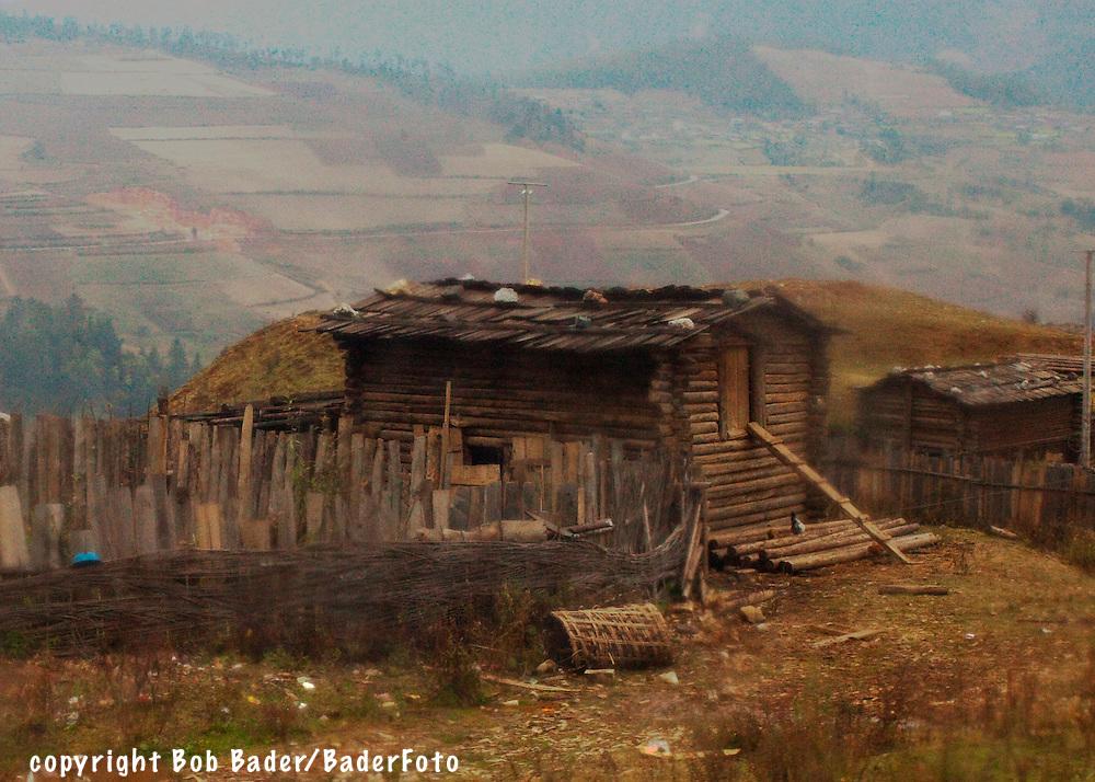 Rude farm buildings on mountain in Shangri-La, China