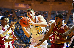 Nov 28, 2018; Morgantown, WV, USA; West Virginia Mountaineers forward Logan Routt (31) grabs a rebound during the second half against the Rider Broncs at WVU Coliseum. Mandatory Credit: Ben Queen-USA TODAY Sports