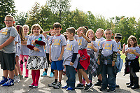 Pleasant Street School students line up to spell G U V (Give United Way) before heading out into the community for their Day of Caring on Thursday morning.  (Karen Bobotas/for the Laconia Daily Sun)
