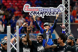 Canon Mullen, the son of Florida Gators head coach Dan Mullen, celebrates after winning the Chick-fil-A Peach Bowl, Saturday, December 29, 2018, in Atlanta. ( Paul Abell via Abell Images for Chick-fil-A Peach Bowl)