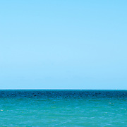 Horizon with a clear blue sky over the turquoise waters off Playa Mujeres, a short distance north of Cancun, Mexico.