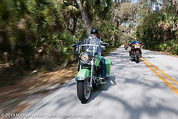 Laura Klock riding through Tomoka State Park with husband Brian following just behind her during Daytona Bike Week. FL, USA. March 11, 2014.  Photography ©2014 Michael Lichter.