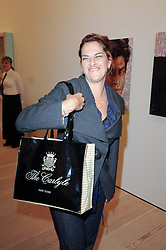 TRACEY EMIN at the BRIC art sale preview (Brazil, Russia, India & China, the acronym BRIC here refers to the burgeoning contemporary art practices within these four countries.) organised by Phillips de Pury & Company at The Saatchi Gallery, London on 17th April 2010.