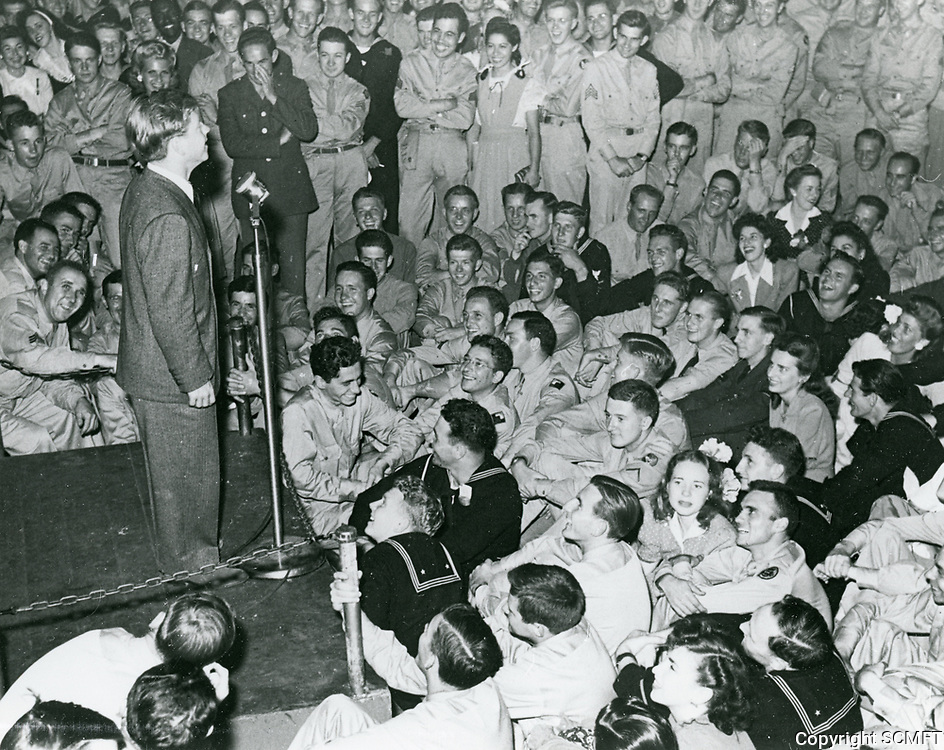 1944 Mickey Rooney on stage entertaining the audience at the Hollywood Canteen.