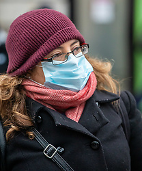© Licensed to London News Pictures. 05/03/2020. London, UK. A women heads to work wearing a mask in Victoria Station as the Government announces plans to combat the coronavirus disease crisis. Photo credit: Alex Lentati/LNP