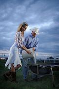 Emily Cochran and Rex Mann feeding horses at Express Personnel Ranch in Yukon, OK