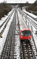 © Licensed to London News Pictures. 11/12/2017. London, UK. A tube train leaves Stanmore station on snow covered tracks. Disruption continues after yesterday's heavy snowfalls in some parts of the UK.  Photo credit: Peter Macdiarmid/LNP