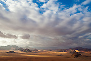 Vast sand desert and sandstone mountains in Wadi Rum, Jordan.