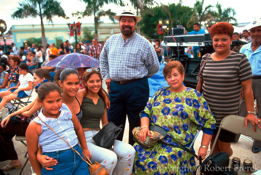 PUERTO RICO, FESTIVALS Three KIngs Festival on Jan 6th in town of Juana Diaz near Ponce; families enjoying the festival in main plaza