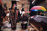 Close family pay homage to the deceased and wear expensive woven cloths, which are often exchanged during such occasions. Batak funeral ceremony..Batak Indigenous Christian people living on Samosir Island and nearby Lake Toba in Indonesia. There are some 6 million Christian Batak in Indonesia, the world's largest Muslim country of 237 million people, which has more Muslims than any other in the world. Though it has a long history of religious tolerance, a small extremist fringe of Muslims have been more vocal and violent towards Christians in recent years. ..Batak religion is found among the Batak societies around Lake Toba in north Sumatra. It is ethnically diverse, syncretic, liable to change, and linked with village organisations and the monotheistic Indonesian culture. Toba Batak houses are boat-shaped with intricately carved gables and upsweeping roof ridges, and Karo Batak houses rise up in tiers. Both are built on piles and are derived from an ancient Dong-Son model. The gable ends of traditional houses, Rumah Bolon or Jabu, are richly decorated with the cosmic serpent Naga Padoha carved in wood or in mosaic, lizards, double spirals, female breasts, and the head of the singa, a monster with protruding eyes that is part human, part water buffalo, and part crocodile or lizard. The layout of the village symbolises the Batak cosmos. They cultivate irrigated rice and vegetables. Irrigated rice cultivation can support a large population, and the Toba and the Karo live in densely clustered villages, which are limited to around ten homes to save farming land. The kinship system is based on marriage alliances linking lineages of patrilineal clans called marga. In the 1820's Islam came to the southern Angkola and Mandailing homelands, and in the 1850's and 1860's Christianity arrived in the Angkola and Toba region with Dutch missionaries and the German Rheinische Mission Gesellschaft. The first German missionary caused the Dutch to stop Batak communal sacrificial ritua