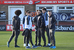Leicester City's Jamie Vardy (right) joins Leicester players on the pitch