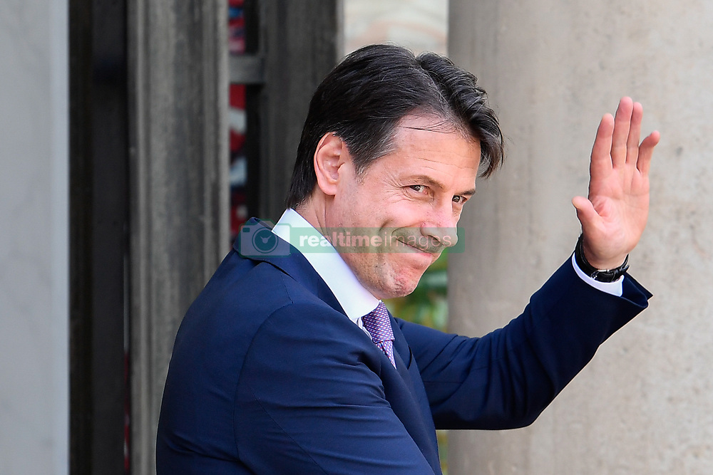June 15, 2018 - Paris, Ile-de-France, France - The new Italian Prime Minister, Giuseppe Conte, waves before a working lunch with President Emmanuel Macron at the Elysee Palace in Paris, France,  on 15 June 2018. (Credit Image: © Julien Mattia/NurPhoto via ZUMA Press)