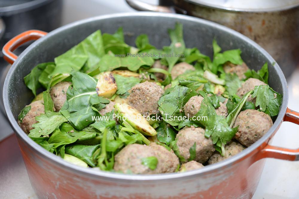 Cooking meatballs - Meatballs cook in a pot