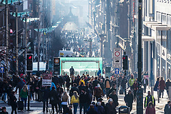 View of busy Buchanan Street on a sunny winter day in Glasgow, Scotland, United Kingdom