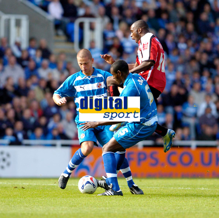Photo: Leigh Quinnell.<br /> Reading v Sheffield United. Coca Cola Championship.<br /> 01/10/2005. Readings Ibrahima Sonko and Ivar Ingimarsson keep Sheffield Uniteds Steven Kabba out of the game.