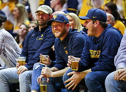 Feb 9, 2019; Morgantown, WV, USA; Country artist Cole Swindell smiles during the first half against the Texas Longhorns at WVU Coliseum. Mandatory Credit: Ben Queen-USA TODAY Sports