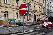 A No Entry traffic sign and a background of a red-themed restaurant, on 18th March, 2018, on Smeralova Street, in Prague 7, the Czech Republic.