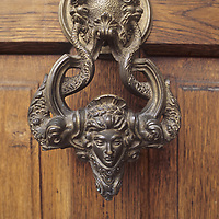 """An ornamental knocker adorns a door at Bran Castle, which is often hyped as """"Dracula's Castle,"""" near Brasov and the Transylvanian Alps in Romania."""