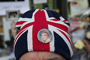 On the 20th anniversary of the death of Princess Diana, crowds of people gather to pay their respects, and to lay flowers, pictures and messages at the memorial to her on 31st August 2017 at Kensington Palace in London, United Kingdom. Diana, Princess of Wales became known as the People's Princess following her tragic death, and now as in 1997, thousands of royalists, and mourners came to her royal residence in remembrance.