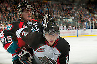 KELOWNA, CANADA - OCTOBER 18: Daniel Gibb #2 of the Prince George Cougars is checked by Colton Sissons #15 of the Kelowna Rockets as the Prince George Cougars visit the Kelowna Rockets on October 18, 2012 at Prospera Place in Kelowna, British Columbia, Canada (Photo by Marissa Baecker/Shoot the Breeze) *** Local Caption ***