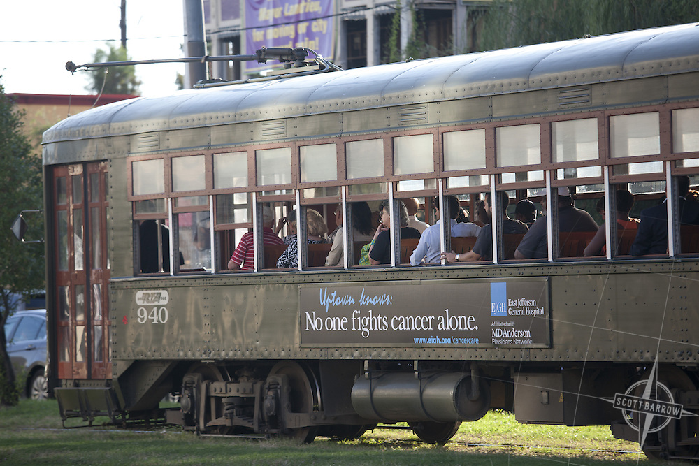 A streetcar with passengers in the Garden District of New Orleans, Louisiana.