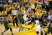 Golden State Warriors guard Stephen Curry (30) takes the ball to the basket against the Utah Jazz during Game 1 of the Western Conference Semifinals at Oracle Arena in Oakland, Calif., on May 2, 2017. (Stan Olszewski/Special to S.F. Examiner)