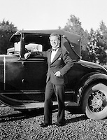 "Man in front of a Ford Model ""T"""