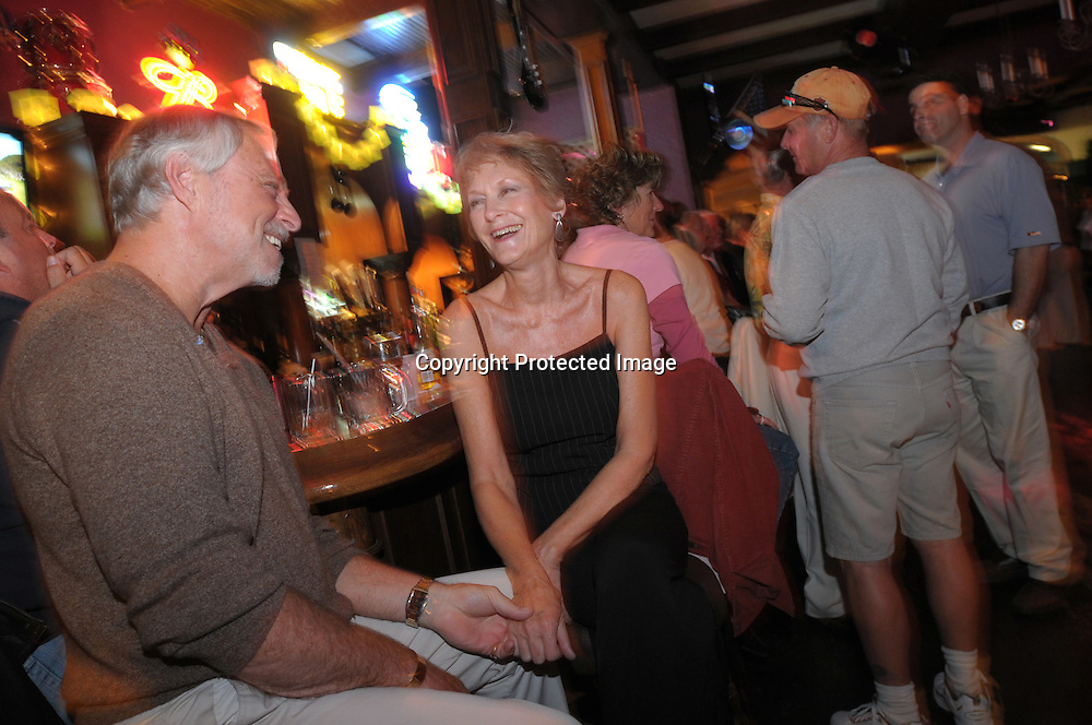 Paul Laski, 63, left, and Jan Morris, 68, share a laugh while enjoying the late night dance scene at the Bourban St. bar in the main downtown square of The Villages, Fla., Saturday, Jan. 17, 2009. (Photo by Phelan M. Ebenhack)