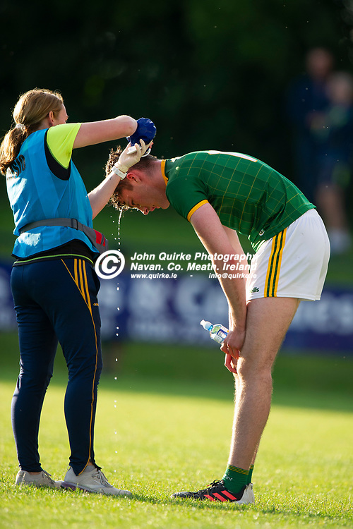 13-07-21. Meath v Wicklow - Leinster U-20 B Hurling Championship (Richie McElligott Cup) 2021 at St. Loman's Park, Trim.<br /> Meath team physio pouring water on Cormac Keys.<br /> Photo: John Quirke / www.quirke.ie<br /> ©John Quirke Photography, 16 Proudstown Road, Navan. Co. Meath. (info@quirke.ie / 046-9028461 / 087-2579454).