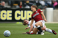 04 December 2011: Stanford's Teresa Noyola (7) is tackled by Duke's Nicole Lipp (behind). The Stanford University Cardinal defeated the Duke University Blue Devils 1-0 at KSU Soccer Stadium in Kennesaw, Georgia in the NCAA Division I Women's Soccer College Cup Final.