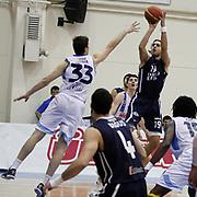Anadolu Efes's Sasha Vujacıc (R) during their Turkish Basketball league derby match  Fenerbahce Ulker between Anadolu Efes at Caferaga Sports Hall in Istanbul, Turkey, Saturday 01, 2012. Photo by TURKPIX